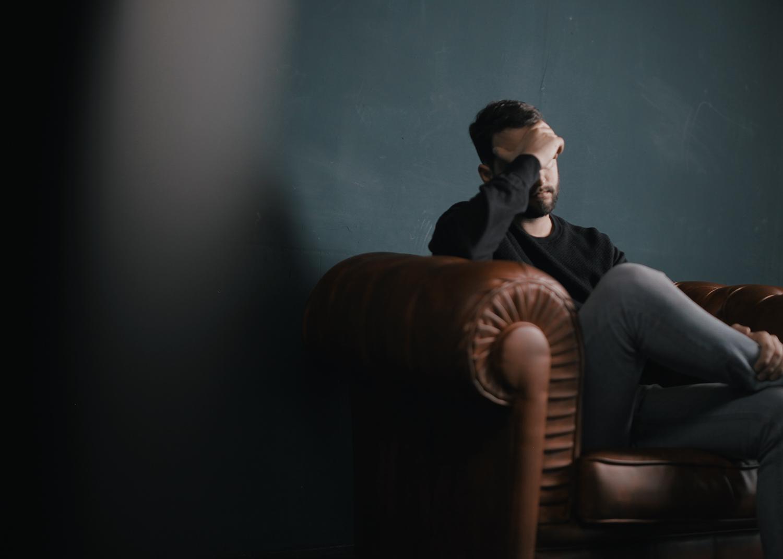 Man sitting in a dark room