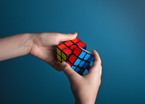 Person solving a rubix cube.
