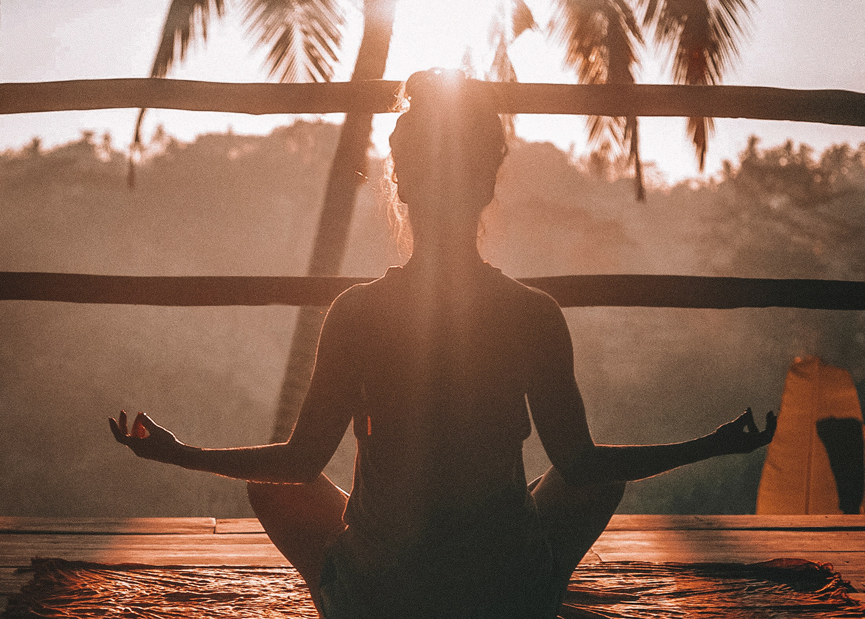 Woman practicing meditation under the sun